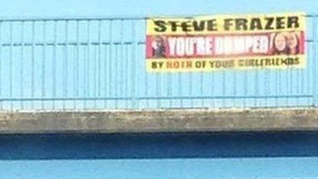 'You're Dumped' Banner hanging over the A1