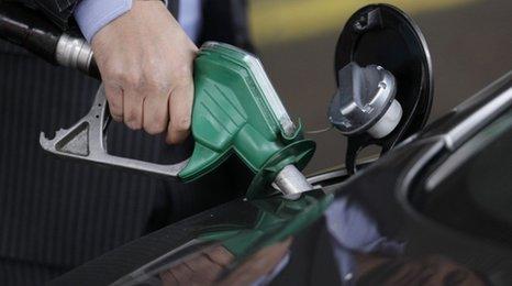 Man fills car up with petrol