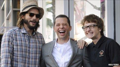 Ashton Kutcher with Two and a Half Men co-stars Jon Cryer and Angus T. Jones.