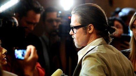 Brad Pitt being interviewed at his latest UK film premiere