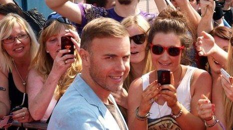Gary Barlow meeting fans outside the auditions