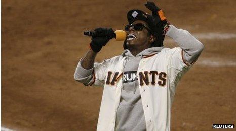Rapper Lil Wayne sings at a baseball game