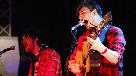 Mumford and Sons performing