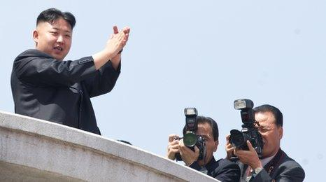 Kim Jong-un applauds during a military parade