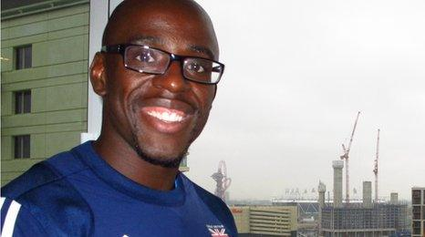 Athlete JJ Jegede pictured in front of shared ownership home near the Olympic Park