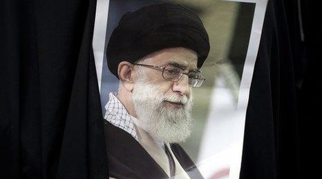 Student holds a picture of the Ayatollah
