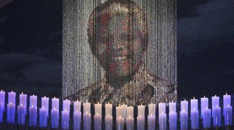 Mandela's picture in front of candles