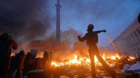 Anti-government protesters clash with the police on Independence Square in Kiev