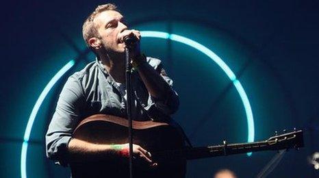 Chris Martin performing at Glastonbury in 2011