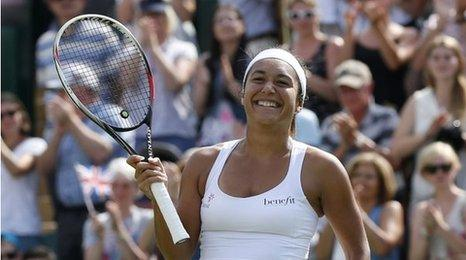 Heather Watson celebrates after beating Croatia's Ajla Tomljanovic in their first round match at Wimbledon on 24 June 2014