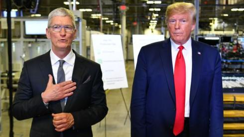 US President Donald Trump (r) and Apple CEO Tim Cook speak to the press during a tour of the Flextronics computer manufacturing facility.