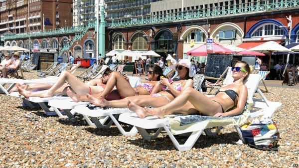 Women sunbathing on the beach