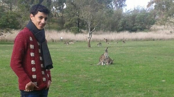 Saad with a kangaroo, after arriving in Australia