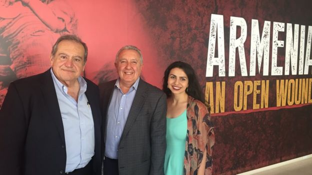 Zaven Kazazian, Berdj Karapetian and Tigrana Zakaryan stand at the entrance to the Armenian exhibit at the Brand Museum in Glendale