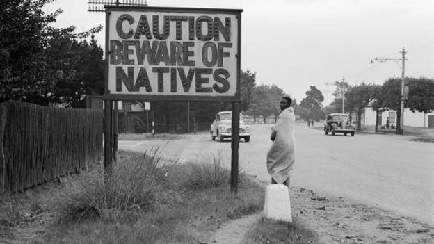 1956: A sign common in Johannesburg, South Africa, reading 'Caution Beware Of Natives'