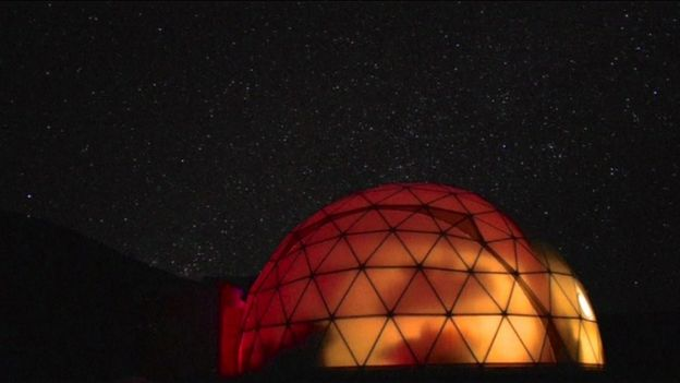 File picture of the HI-SEAS dome in Hawaii lit up a night.