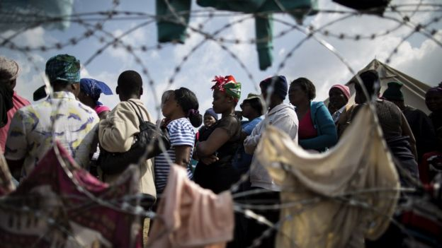 Displaced people who fled the anti-immigrant violence are seen in a camp on April 19, 2015 in the village of Primrose, 15 kms east of Johannesburg