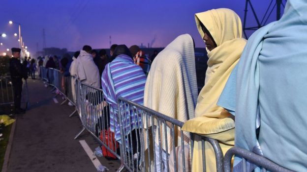 Migrants awaiting evacuation from the Calais camp in France