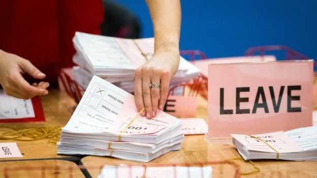 A teller counts ballot papers at the Titanic Exhibition Centre, Belfast