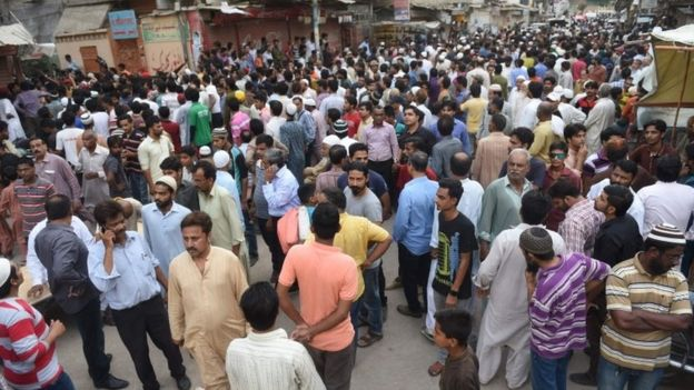 Crowd in street outside Sabri's home