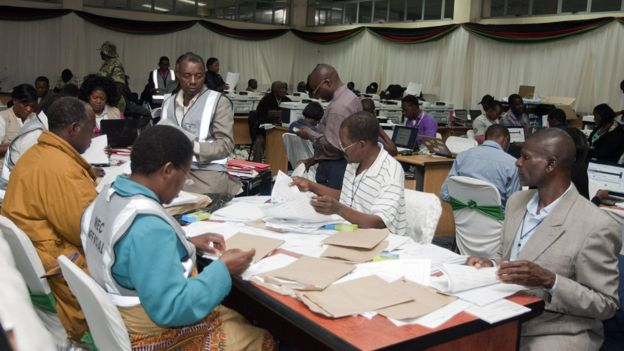Malawi Electoral Commission workers recount votes during the national elections, 24 May 2014