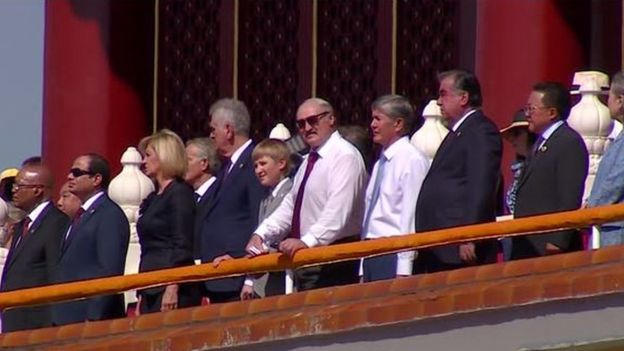 Kolya and Alexander Lukashenko watch Beijing's massive military parade on 3 September