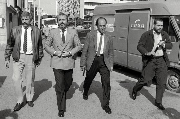 Judge Giovanni Falcone (second from left) with bodyguards in Marseilles, investigating the Mafia's international links