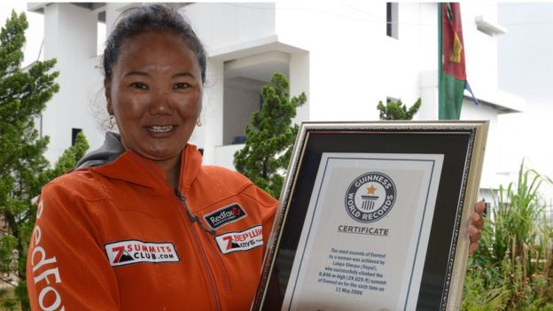 Nepalese climber Lhakpa Sherpa, who holds the world record for most successful climbs of Mount Everest for a woman with seven ascents, poses with her Guinness record certificate in Kathmandu on May 27, 2016.