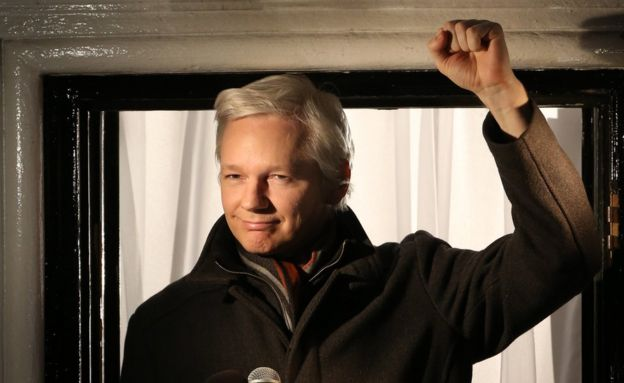 Wikileaks founder Julian Assange holds up a fist at the Ecuadorian Embassy in London on December 20, 2012