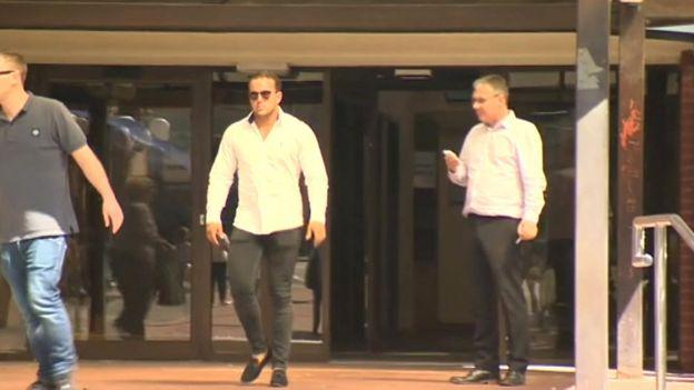 Grant Hare leaving court
