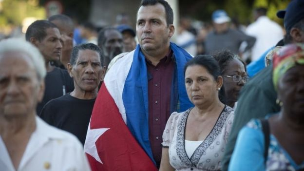 Mourners wait to enter the Revolution Plaza in Havana, Cuba, Monday, Nov. 28, 2016.