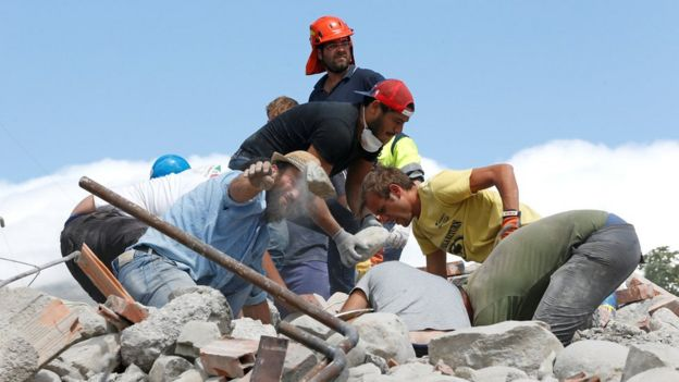 Rescuers work following an earthquake in Amatrice, central Italy