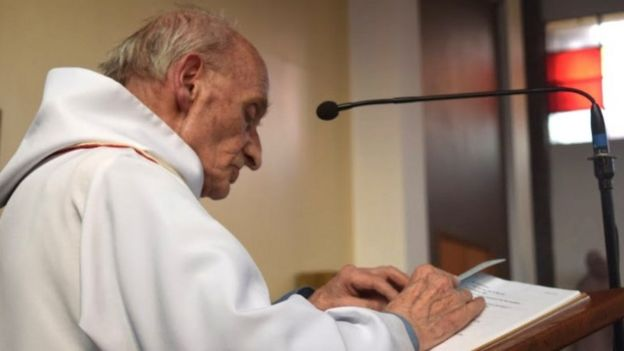 Father Jacques Hamel seen reading in an undated image