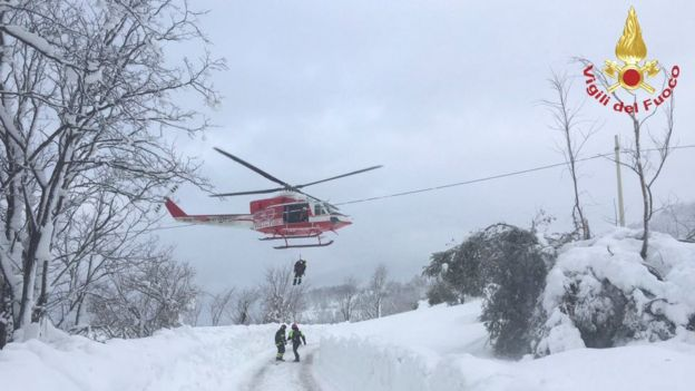 Rescuers arrive by helicopter