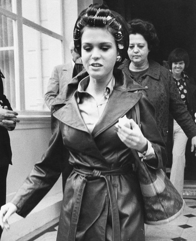 Singer Marie Osmond wearing curlers in her hair, as she leaves Belgrave House Hotel, London, 1975