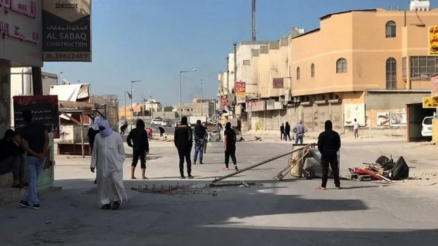 Anti-government protestors block the road in the Jidhafs district of Bahrain, on 15 January 2017