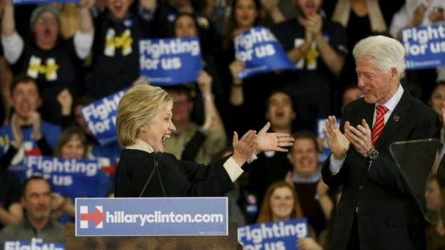 Democratic US presidential candidate Hillary Clinton is applauded by her husband, former US President Bill Clinton in Hooksett, New Hampshire on 9 February 2016.