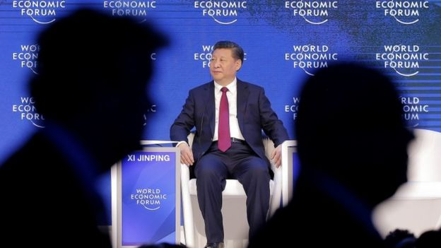 China's President Xi Jinping seated at the Davos conference