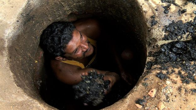 Binod Lahot in a sewer