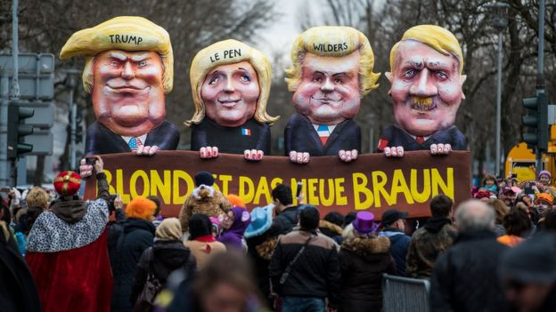 President Donald Trump (L-R), Marine Le Pen of Front National, Geert Wilders of Partij voor de Vrijheid and Adolf Hitler drives in the annual Rose Monday parade on February 27, 2017 in Dusseldorf, Germany.