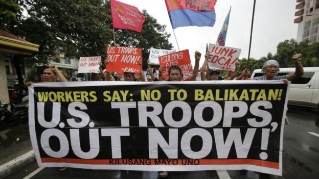 Filipino activists rally against the Enhanced Defense Cooperation Agreement (EDCA) between the U.S. and Philippines in front of the U.S. embassy in Manila, Philippines on Tuesday, Oct. 4, 2016.