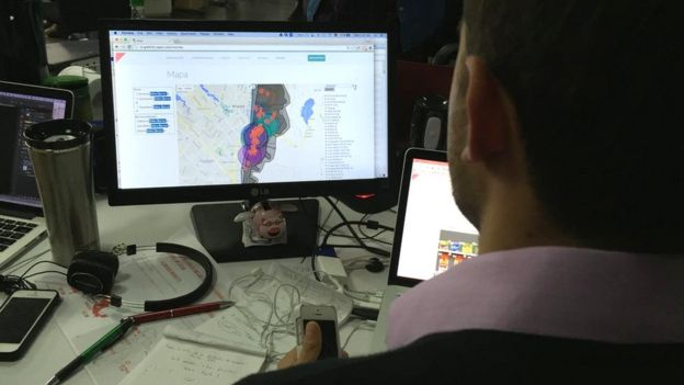 Man monitoring map in Rappi office