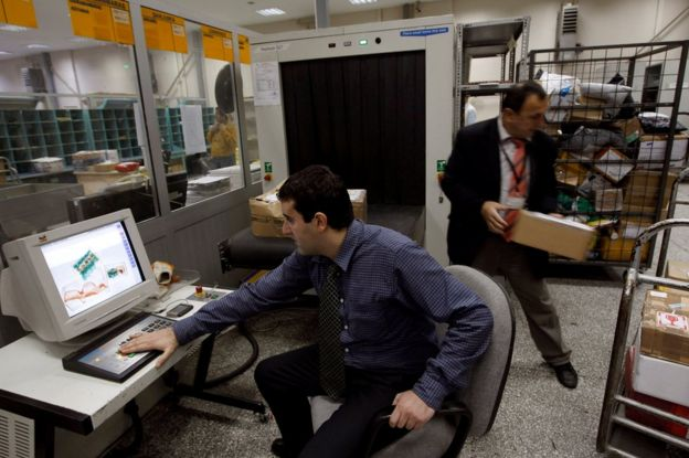 A security official looks at a screen displaying X-ray screened parcels in Turkish Post's (PTT) postal logistic centre at the Ataturk International airport in Istanbul, Turkey, 6 November 2010