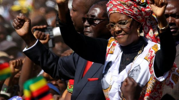 President Robert Mugabe and his wife Grace greet supporters of his ZANU (PF) party during the