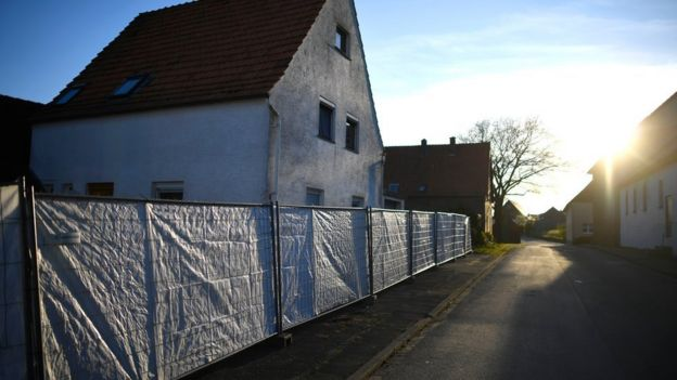 The residence of the suspects is surrounded by a police fence during sunset on 2 May, 2016 in Bosseborn village near Hoexter, Germany.