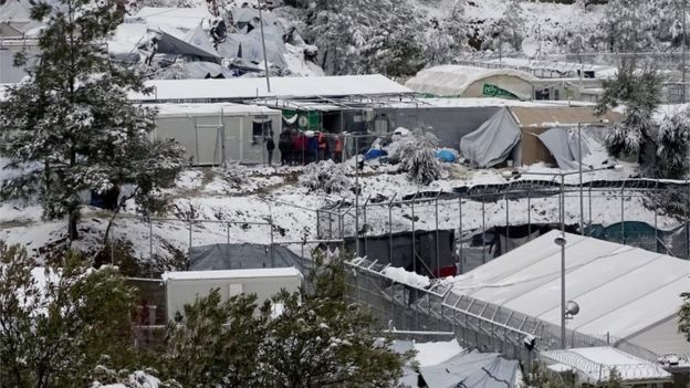 Snow covers tents on the Greek island of Lesbos, 7 January 2017