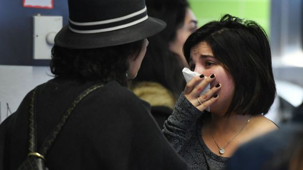 A woman of Iranian descent (R) cries as she waits for a family member after the immigration ban imposed by U.S. President Donald Trump at the Los Angeles International Airport, 30 January