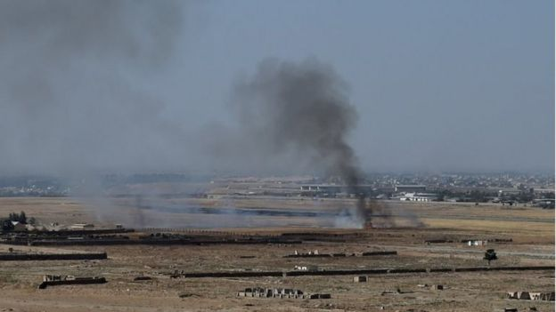 Smoke rises near an Afghan military base during fighting between Taliban militants and Afghan security forces in Kunduz on 1 October 2015.