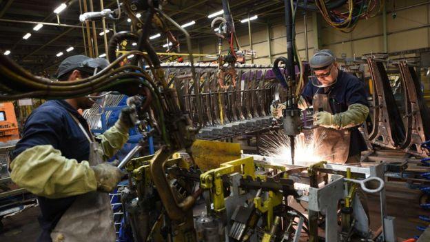 Two workers weld vehicle panels in Nissan's Sunderland factory in north east England, 12 Nov 2014