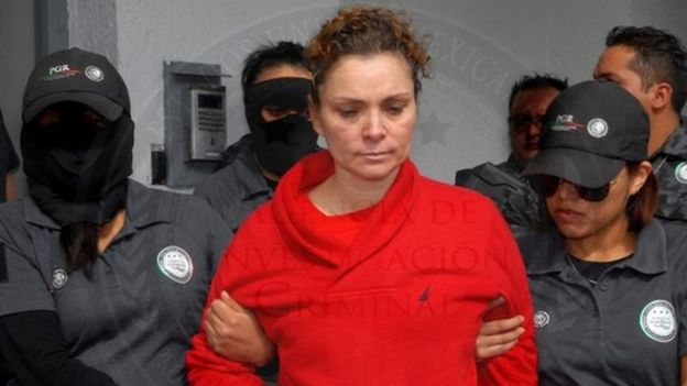 Maria de los Angeles Pineda (C), wife of former Mayor of Iguala, Jose Luis Abarca and allegedly connected to the case of forced disappearance of the 23 students on September 2014, guarded by Mexican authorities in Mexico City, Mexico, 12 January 2014.